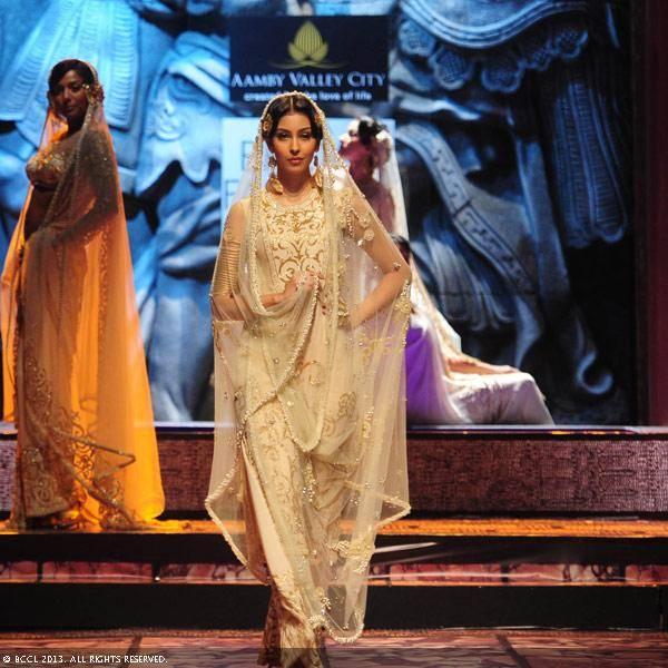 Miss Universe Canada Sahar Biniaz walks the ramp for designer Suneet