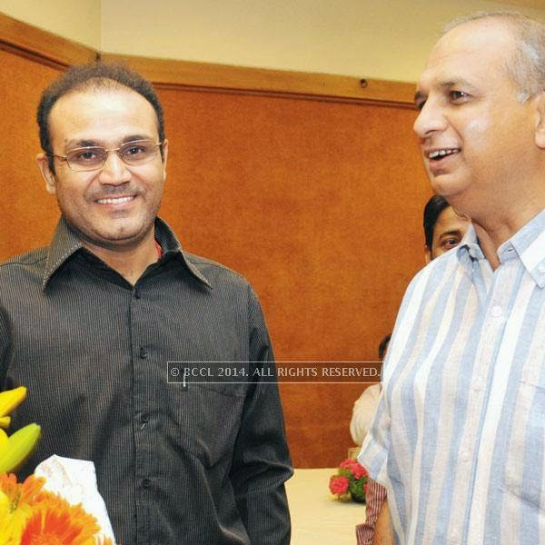 Virender Sehwag (L) and Ravi Jain, joint secretary, DDCA during the birthday party of former cricketer and ex-MP, Chetan Chauhan, held in Delhi.