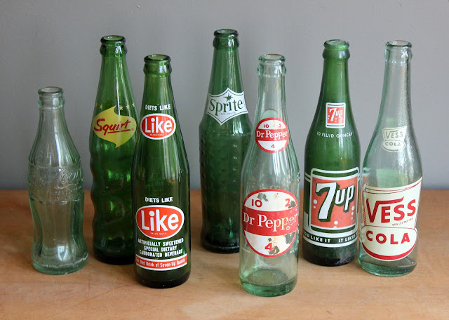 Assorted small green soda bottles available for rent from www.momentarilyyours.com, $1.00 each.