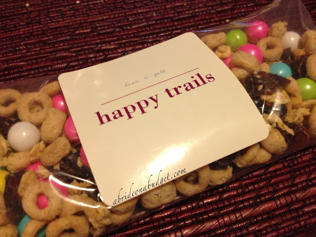 You should DEFINITELY send your wedding guests home with a late night snack ... and these Happy Trails trail mix wedding favors from www.abrideonabudget.com are PERFECT.