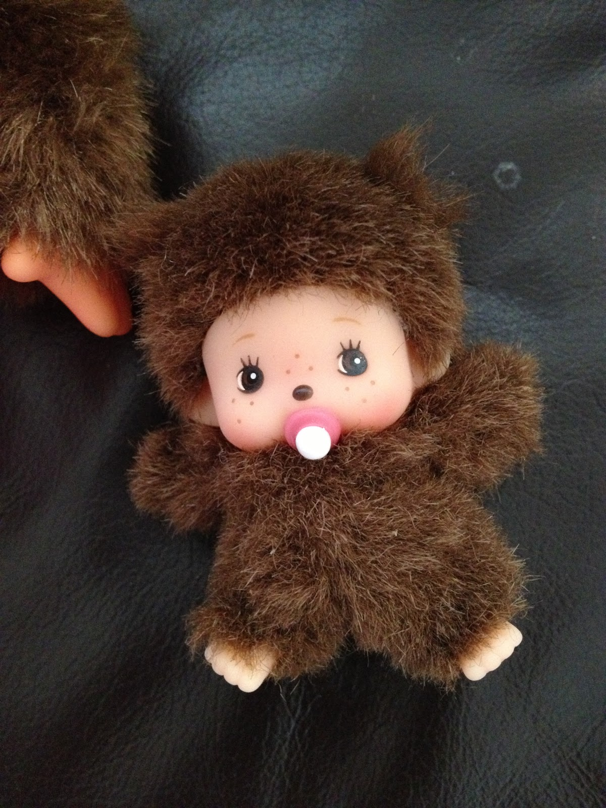 274d8a1c9d6f6 We love that there's a teeny baby monchhichi in a baby sling attached to  the pink dress (the baby was held on by a stitch and I took the decision to  ...
