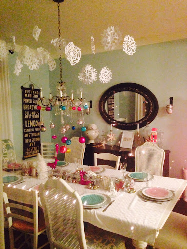 Hanging snowflakes over dining table