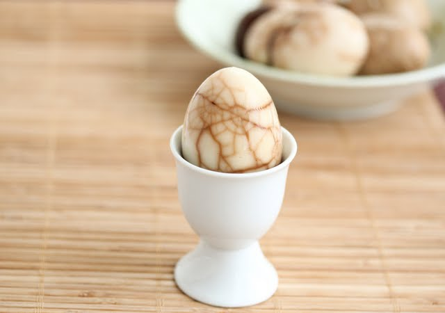 close-up photo of a tea leaf egg in an egg cup