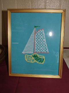 Margaret's unique wooden shoe with sails in bobbin lace. Wynken Blynken & Nod would've loved sailing in this boat!