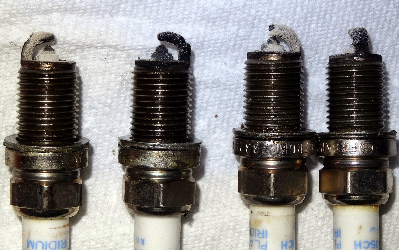 Misfiring Fouled Spark Plugs And Excessive Oil Consumption