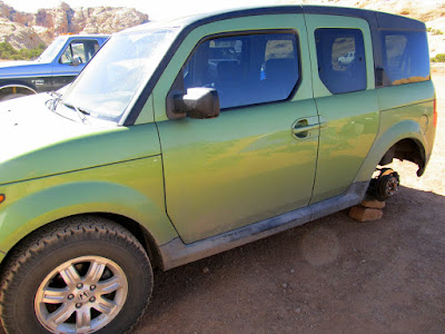 Honda Element minus one of its BFG All-Terrains