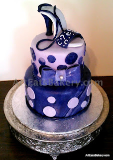 Purple marbled fondant 2 tier lady's birthday cake with polka dot design, edible bow and hand made shoe topper