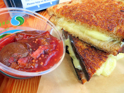 From Lardo, the Jenn Louis chefwich, a grilled cheese with fontina cheese, plum conserva on Grand Central Bakery sour rye. A portion of the proceeds of the sandwich benefits the Oregon Food Bank.