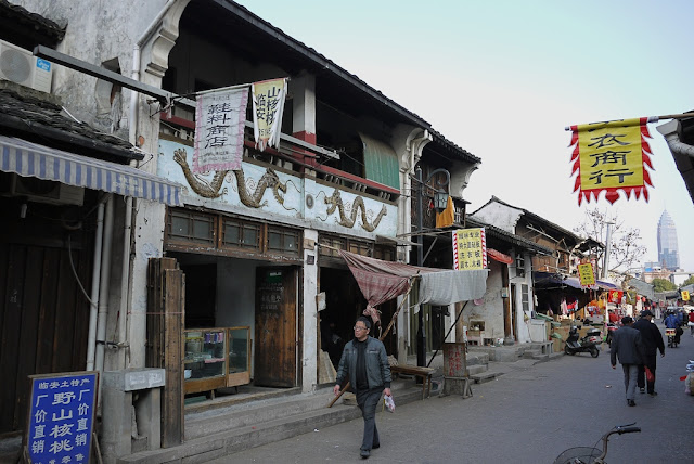 man walking at Xiaoshan Street in Shaoxing, China