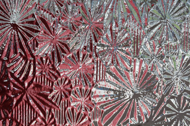 looking through interestingly-textured glass at something red