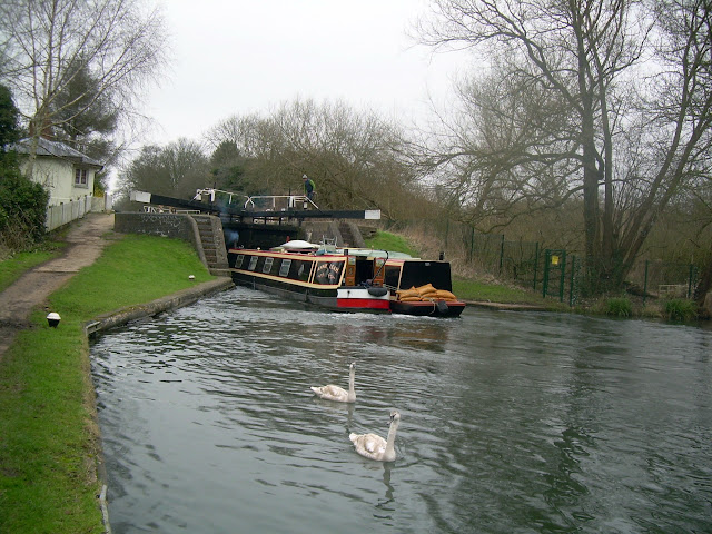 Narrowboats entering a lock