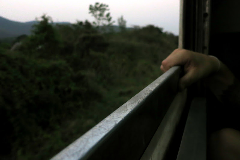 Hand on the train window