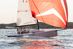 J/70 one-design sailboat- sailing with women's team
