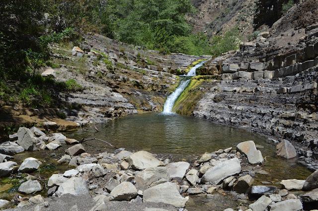 a cascade into a pool
