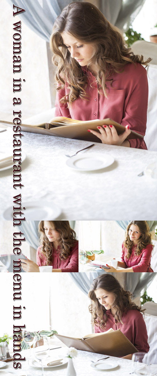 Stock Photo: A woman in a restaurant with the menu in hands