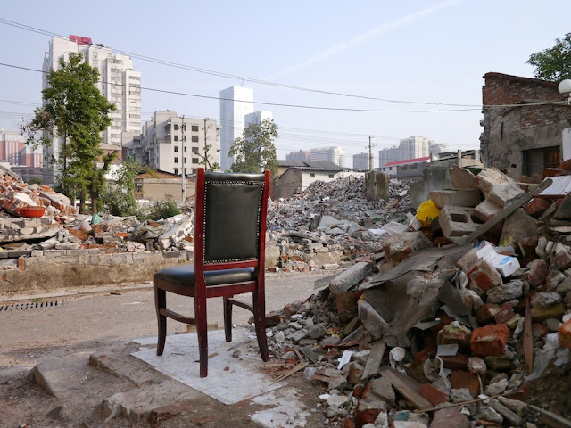 a chair sitting next to rubble near Beizheng Street in Changsha