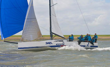 J/111 sailboat- sailing fast under spinnaker in Netherlands