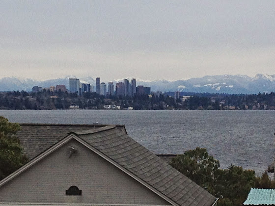 Looking east from Cherry Street in Madrona / Leschi at the Bellevue Skyline and the Cascade Mountains.