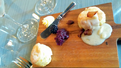 Tesoaria Portland Tasting Room January brunch: A sweet and savory duo of fresh buttermilk biscuits -the first with house prepared honey butter and blackberry dolcetto preserve, and the second with thick country style gravy