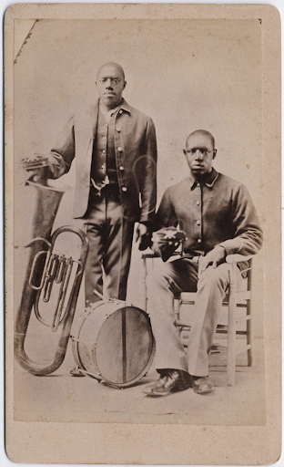 two unidentified buffalo soldiers with musical instruments