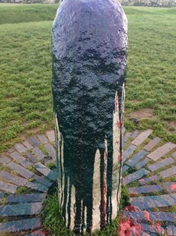 Ancient standing stone daubed with paint