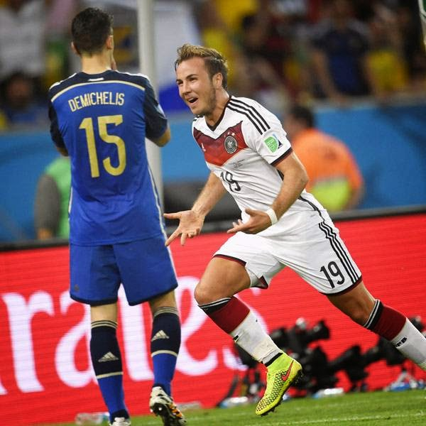Germany's forward Mario Goetze runs past Argentina's defender Martin Demichelis as he celebrates scoring during extra time of the 2014 FIFA World Cup final football match between Germany and Argentina at the Maracana Stadium in Rio de Janeiro on July 13, 2014.