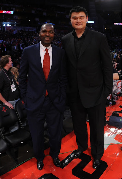 NBA Legends Hakeem Olajuwon and Yao Ming stand courtside during the 2013 NBA All-Star Game presented by Kia on February 17, 2013 at the Toyota Center in Houston, Texas.