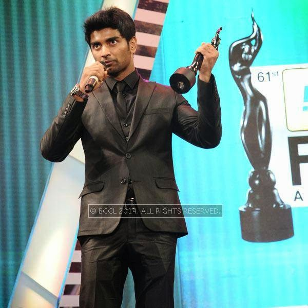 Atharvaa speaks after receiving Best Actor Award for male in Tamil for his performance in the film 'Paradesi' during the 61st Idea Filmfare Awards South, held at Jawaharlal Nehru Stadium in Chennai, on July 12, 2014.