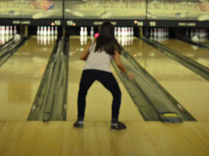 how to get good bowling action