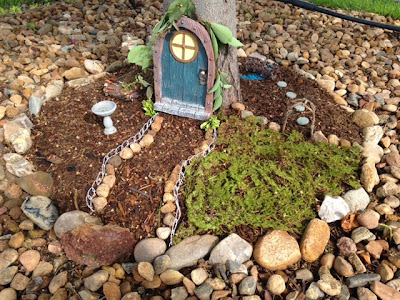 fairy garden pathway with birdhouse, swimming hole, picnic table, bridge, and raised garden bed www.thebrighterwriter.blogspot.com