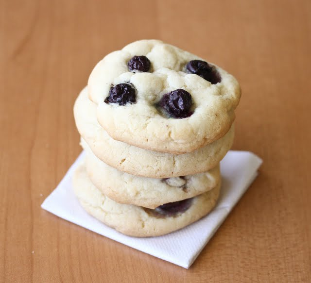 a close-up photo of a stack of blueberry cheesecake cookies