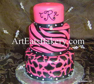 Three tier girl's animal print black and pink fondant birthday cake with monogram, rhinesrones and beads