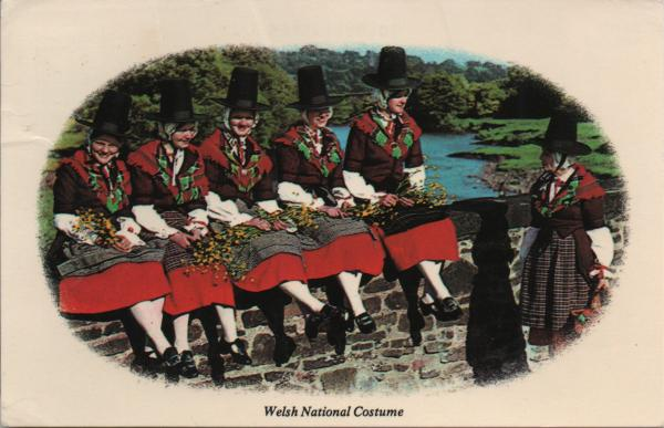 girls wearing Welsh costume on a bridge