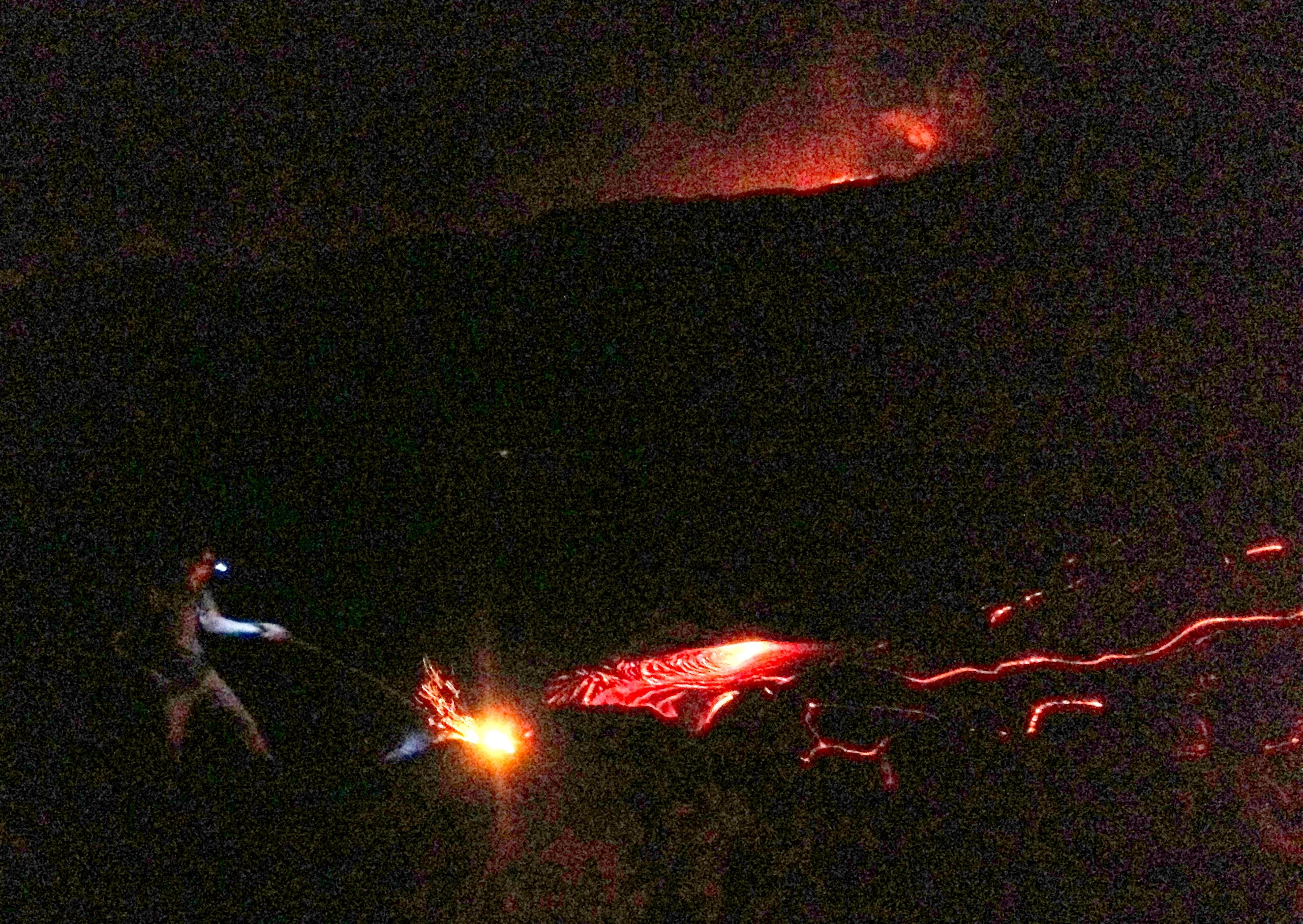 Jack playing with the lava flow. The steam at the top right background is where the lava meets the ocean.