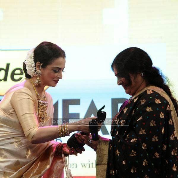 Actress Rekha presents the Lifetime Achievement Award to Jayabharathi during the 61st Idea Filmfare Awards South, held at Jawaharlal Nehru Stadium in Chennai, on July 12, 2014.