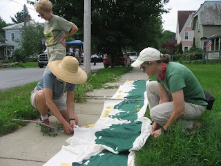 Our 2nd Bristol 4th of July parade, 2013. Setting up the Nuquist's beautiful Green Mountains LT banner.