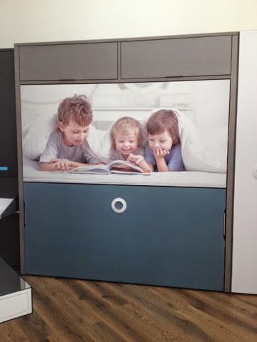 litera abatible con una foto de 3 niños