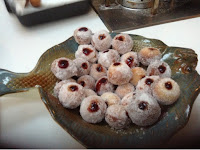 mini jam doughnuts in a fish shaped dish
