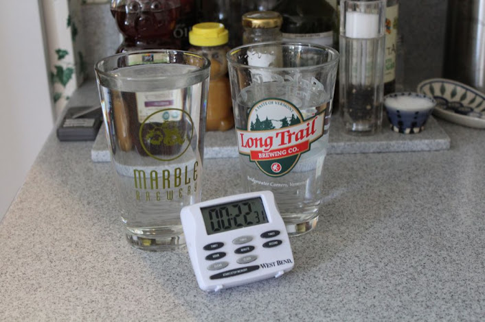 two glasses of water and a timer