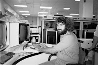 Photograph of Ken Bowler sitting at a 3270 display in the UBC machine room