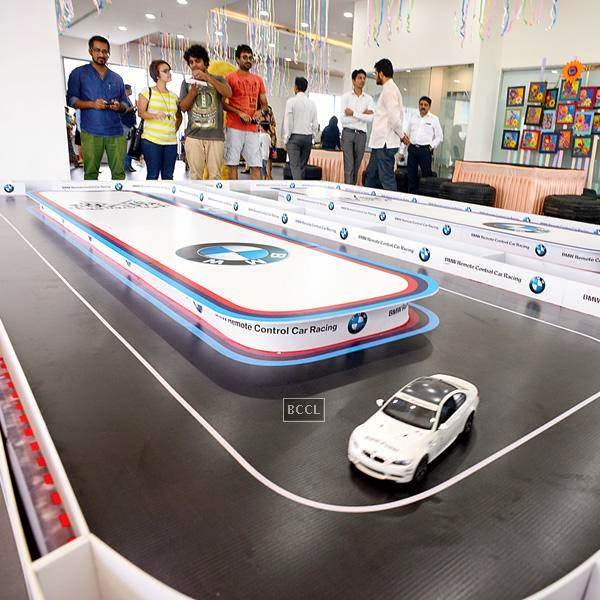 People enjoy the RC car racing during an event organised by BMW Parsoli Motors and Little Big Joys.