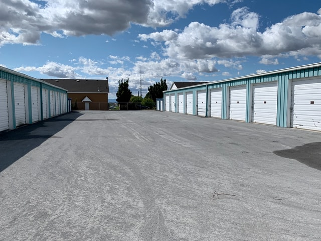 A wide commercial space with several storage units