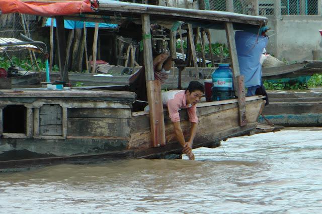 Mekong Delta man op boat