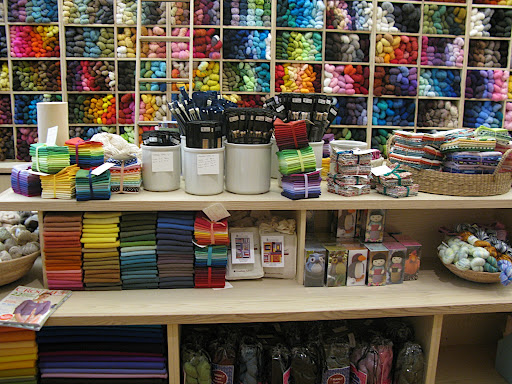 so much beautiful fabric, yarn, and tools