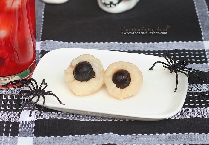 "Making the ""eyeballs"" is very easy. Just stick one grape, into the ..."