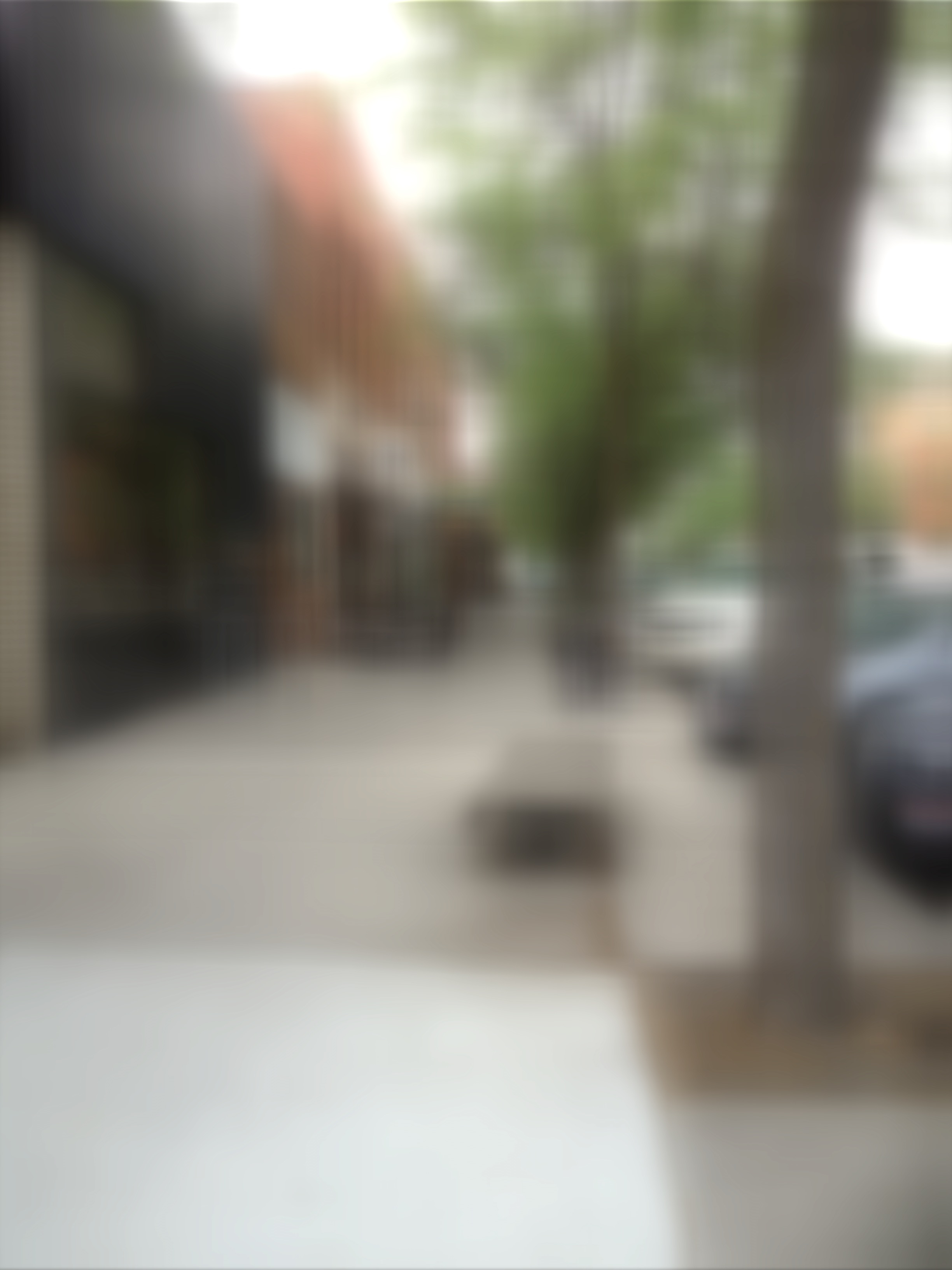 same street scene totally out of focus. The temperature sign is not distinguishable at all.