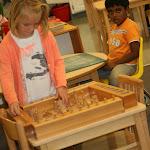 Montessori preschool girl in Irvine working with cylinder block for sensorial development.