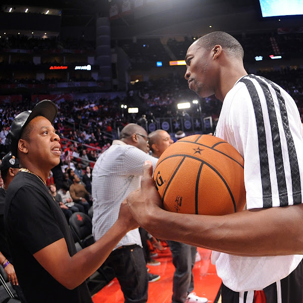 Dwight Howard #12 of the Western Conference All-Stars talks with recording artist Jay-Z during the 2013 NBA All-Star Game presented by Kia on February 17, 2013 at the Toyota Center in Houston, Texas.