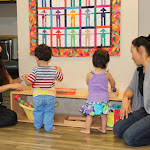 """Moms learn what Dr. Montessori meant by """"follow the child"""" as children take the lead on exploring by themselves in the LePort Schools Infant Parent & Child Montessori class with shelves built just for the older infant."""
