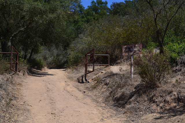 gate with trail around the edge but now wide open